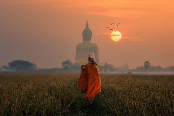 Buddha background and monk walking away