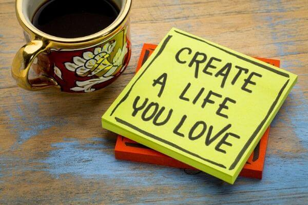 Yellow sticky note with a message: Create a life you love