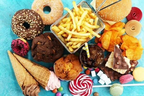 Lots of junk food, donuts, fries, ice cream, candy