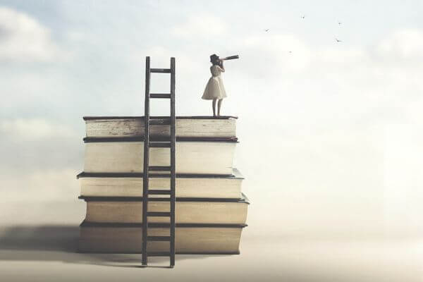 lady on top of books looking at horizon