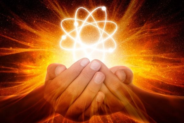 Hands holding esoteric symbol